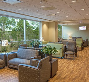 Hospital waiting room featuring lounge chairs, loveseats, sofas, guest chairs and occasional tables. Furniture for healthcare settings