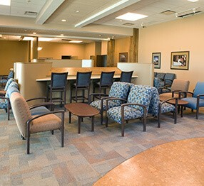 A different angle of the hospital waiting room features Kwalu's counter stools for ease of working and oslo seating which can be ganged in multiple configurations by including inline tables. Perfectly designed for healthcare settings, they are at home in any hospital lobby or waiting room.