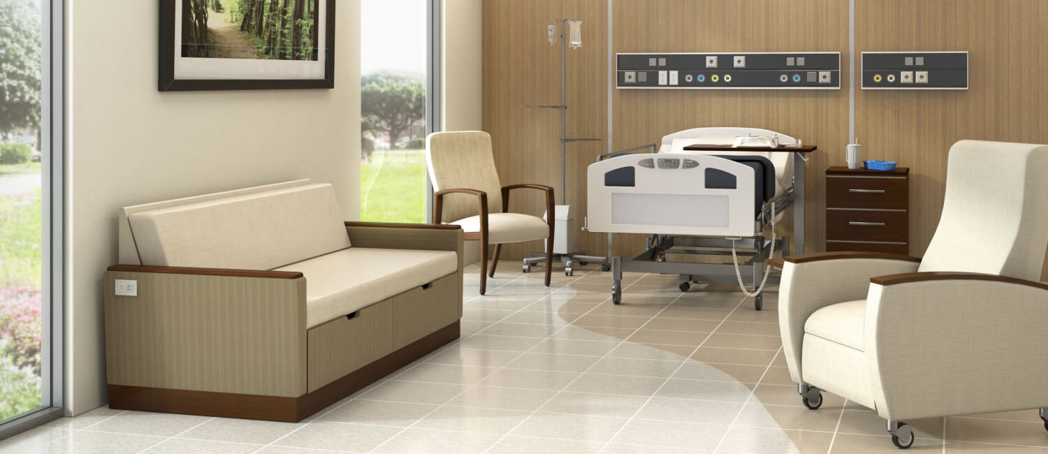 Kwalu's healthcare furniture is ideally suited to hospital patient room settings. This image features Kwalu's flip-down Carrara double sleeper loveseat, the Valentia wall-saver patient chair, the Valentia motorized recliner with optional heating and massage, Kwalu's Hollywood casegoods bedside cabinet and Kwalu's repairable wall protection as a headwall.