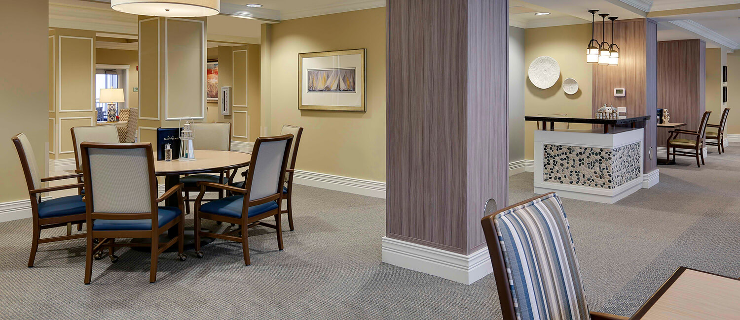Examples of dining room and lounge area furniture, custom-designed to meet the needs of assisted living environments.